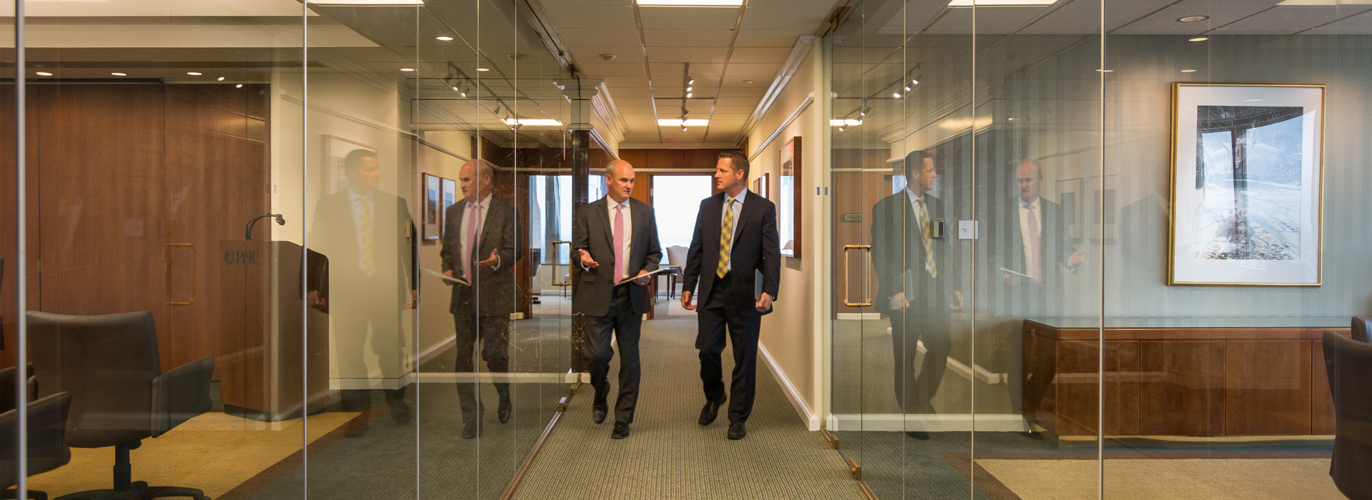 Santora CPAs in hallway discuss the connections between healthcare providers, Delaware holding companies and closely-held businesses